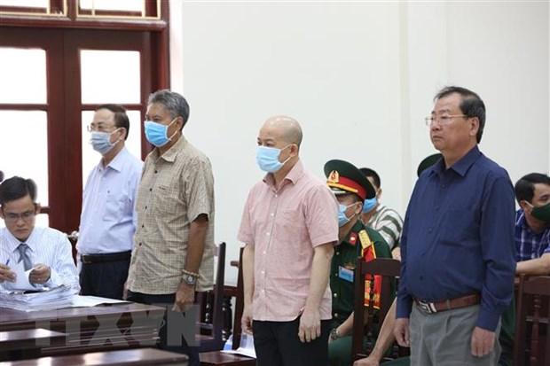 Các bị cáo tại phiên xét xử sơ thẩm. Ảnh:TTXVN