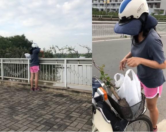 Người phụ nữ đi xe máy hái trộm cây trồng ven cầu. Nguồn: M.T