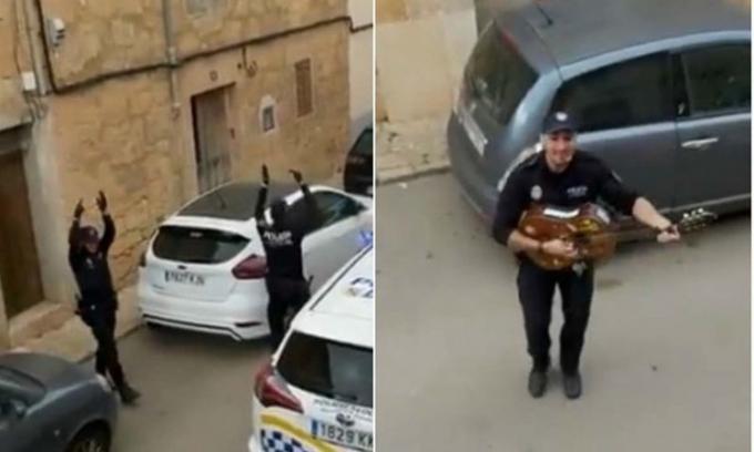 Cảnh sát Tây Ban Nha đàn hát cổ vũ người dân bị phong tỏa vì dịch Covid-19