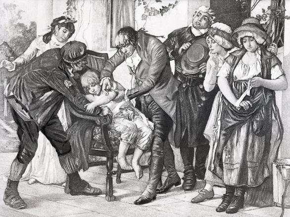 Bức vẽ mô tả vắcxin bệnh đậu mùa đầu tiên của bác sĩ người Anh Edward Jenner, thực hiện trên cậu bé James Phipps vào năm 1796 - Ảnh: BETTMANN / GETTY