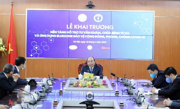 Thủ tướng Nguyễn Xuân Phúc dự lễ khai trương nền tảng hỗ trợ tư vấn khám chữa bệnh từ xa. (Ảnh: Thống Nhất/TTXVN)