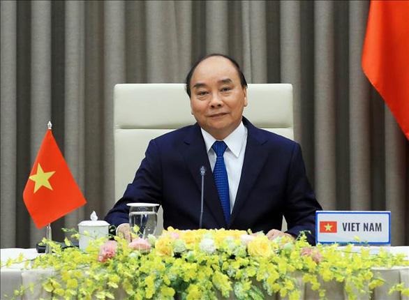 Thủ tướng Nguyễn Xuân Phúc phát biểu tại cuộc họp trực tuyến của WHO - Ảnh: TTXVN