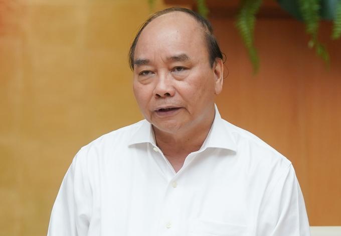 Thủ tướng Nguyễn Xuân Phúc chủ trì họp Thường trực Chính phủ về phòng chống Covid-19, chiều 24/6. Ảnh: VGP