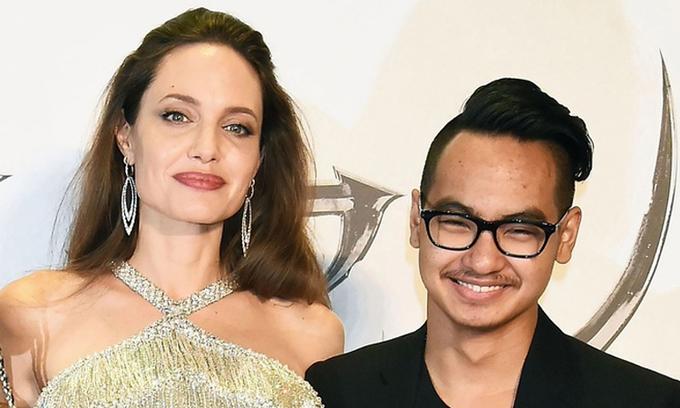 Maddox (phải) được Angelina Jolie nhận nuôi trước khi hẹn hò Brad Pitt. Ảnh: AFP.